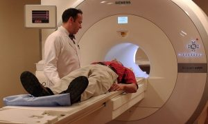Male patient in CT scanner