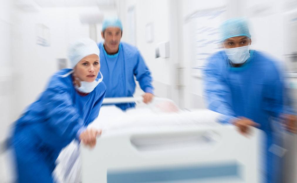 Doctors rushing patient experiencing carcinoid crisis